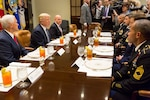 From left, Vice President Mike Pence, President Donald J. Trump, and National Security Advisor Army Lt. Gen. H.R. McMaster talk with service members