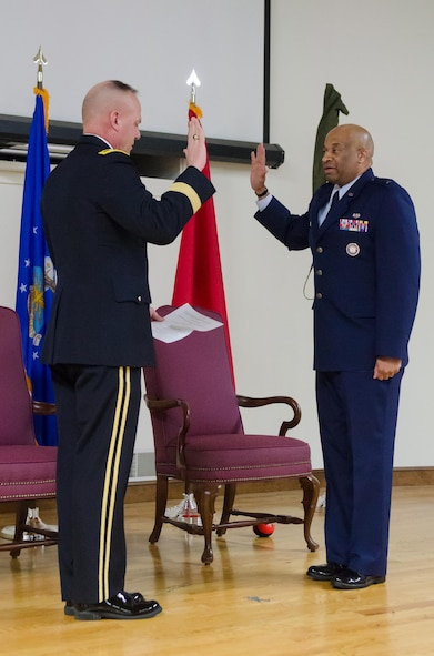 Charles M. Walker, chief of staff for Headquarters, Kentucky Air National Guard, is promoted to the rank of brigadier general during a ceremony held at the Kentucky Air National Guard base in Louisville, Ky., Nov. 4, 2017. Promoting Walker to the new rank is Army Maj. Gen. Steven R. Hogan (left), adjutant general of the Kentucky National Guard. (U.S. Air National Guard photo by Tech. Sgt. Vicky Spesard)