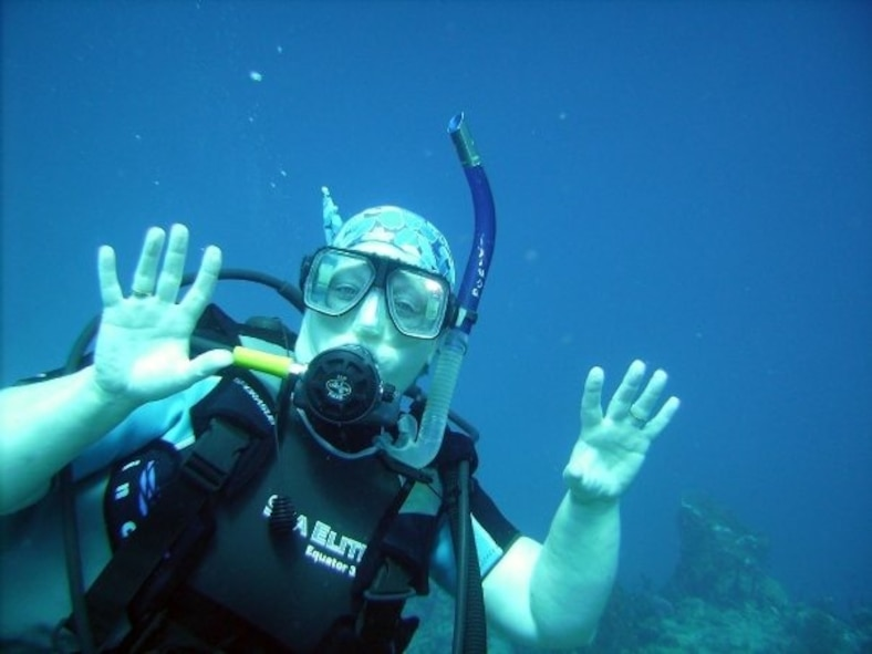 Tina Poe, 940th Air Refueling Wing Commander's Secretary, poses underwater for the camera April 2012, in Roatan near Honduras.