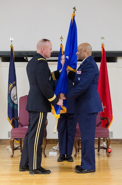 Army Maj. Gen. Steven R. Hogan (left), adjutant general of the Kentucky National Guard, presents the brigadier general flag to Charles M. Walker, chief of staff for Headquarters, Kentucky Air National Guard, during Walker's promotion ceremony at the Kentucky Air National Guard base in Louisville, Ky., Nov. 4, 2017. (U.S. Air National Guard photo by Tech. Sgt. Vicky Spesard)