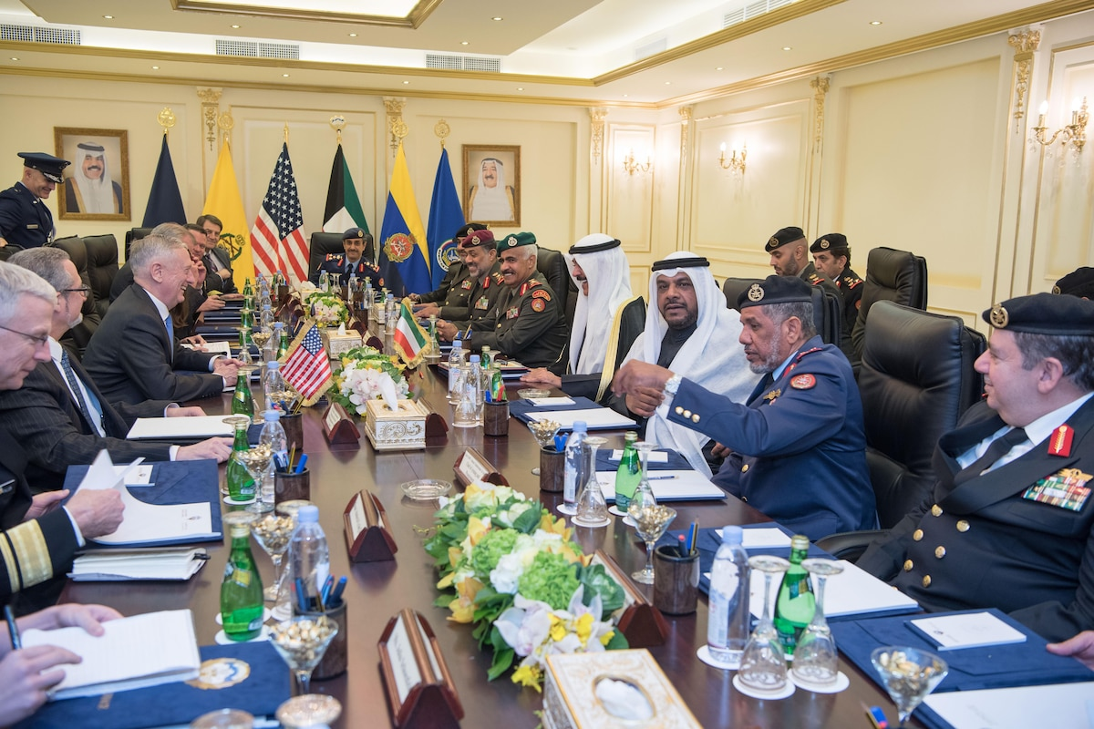 Defense Secretary James N. Mattis sits at a table for a meeting with Kuwaiti leaders.