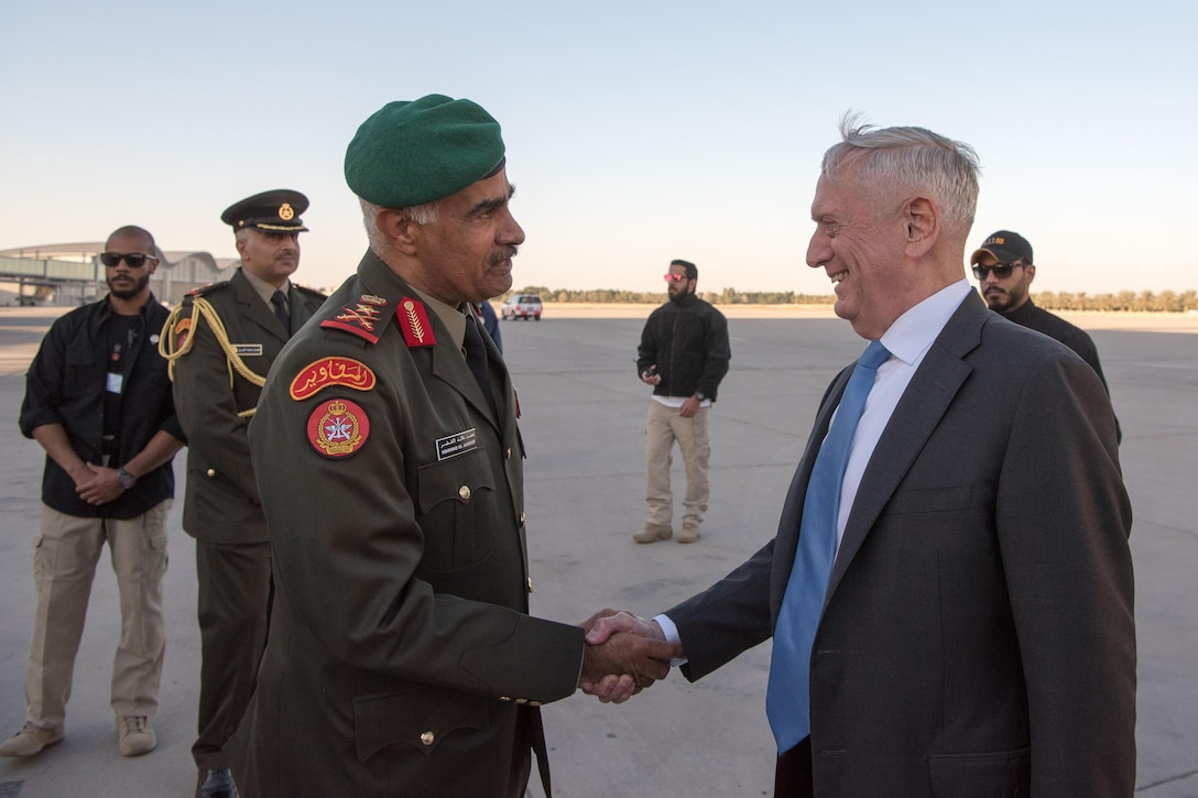 Defense Secretary James N. Mattis shakes hands with a Kuwaiti military officer.