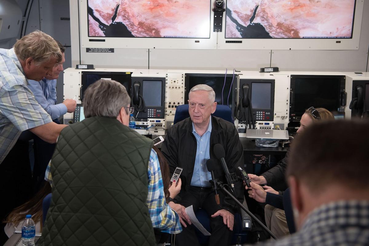 Defense Secretary James N. Mattis speaks with reporters aboard a plane.