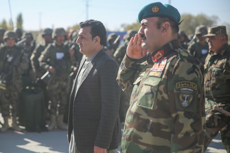 Sardar Mohammed Hamdard, left, the first deputy governor of Helmand province, and Afghan National Army Maj. Gen. Wali Mohammed Ahmadzai, center-right, the commanding general of 215th Corps, pass and review ANA soldiers with 6th Kandak, 1st Brigade, 215th Corps during a graduation ceremony at Camp Shorabak, Afghanistan, Dec. 3, 2017. The event concluded an eight-week operational readiness cycle, which was led by Afghan instructors at the Helmand Regional Military Training Center. Hundreds of soldiers with 6th Kandak, 1st Brigade developed their individual and collective infantry skills throughout the course to more effectively combat the Taliban in the province. (U.S. Marine Corps photo by Sgt. Lucas Hopkins)