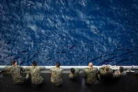 U.S. Marines with Fox Company, Battalion Landing Team, 2nd Battalion, 6th Marine Regiment, 26th Marine Expeditionary Unit, wait for a meritorious promotion ceremony to commence aboard the dock landing ship USS Oak Hill in the Atlantic Ocean, Dec. 2, 2017, during Combined Composite Traiing Unit Exercise. Combined COMPTUEX allows all elements of the Marine Air Ground Task Force to join and train in realistic scenarios so the MEU as a whole can meet its Predeployment Training Program objectives prior to an upcoming deployment at sea.