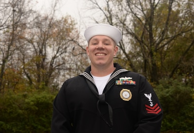 A sailor poses for a photo