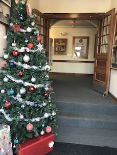 Marine Corps Engineer School (MCES) spouses placed decorations around the headquarters building for the upcoming holiday season on December 1, 2017.
