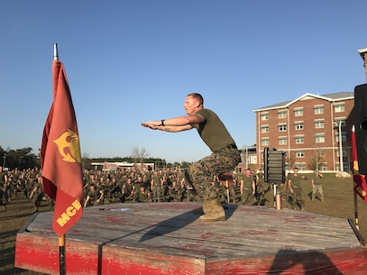 Gunnery Sergeant Lloyd Crabtree, the Force Fitness Instructor (FFI) for Marine Corps Engineer School; leads the school physical training session on December 1, 2017 at Courthouse Bay, N. C. As the FFI, GySgt Crabtree developed, demonstrated, and led the school through a dynamic warm-up, physically demanding modified circuit course, and cool-down period.