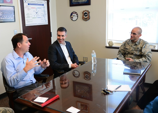 Greg Raap, Hunt Companies Vice President, and John Ehle, Hunt Companies President, talk with Col. Anthony Sansano, 14th Mission Support Group Commander, Nov. 28, 2017, on Columbus Air Force Base, Mississippi. Ehle and Raap were here to receive feedback, check on the local Hunt Companies branch and establish a working relationship with Columbus AFB leadership. (U.S. Air Force photo by Airman 1st Class Beaux Hebert)