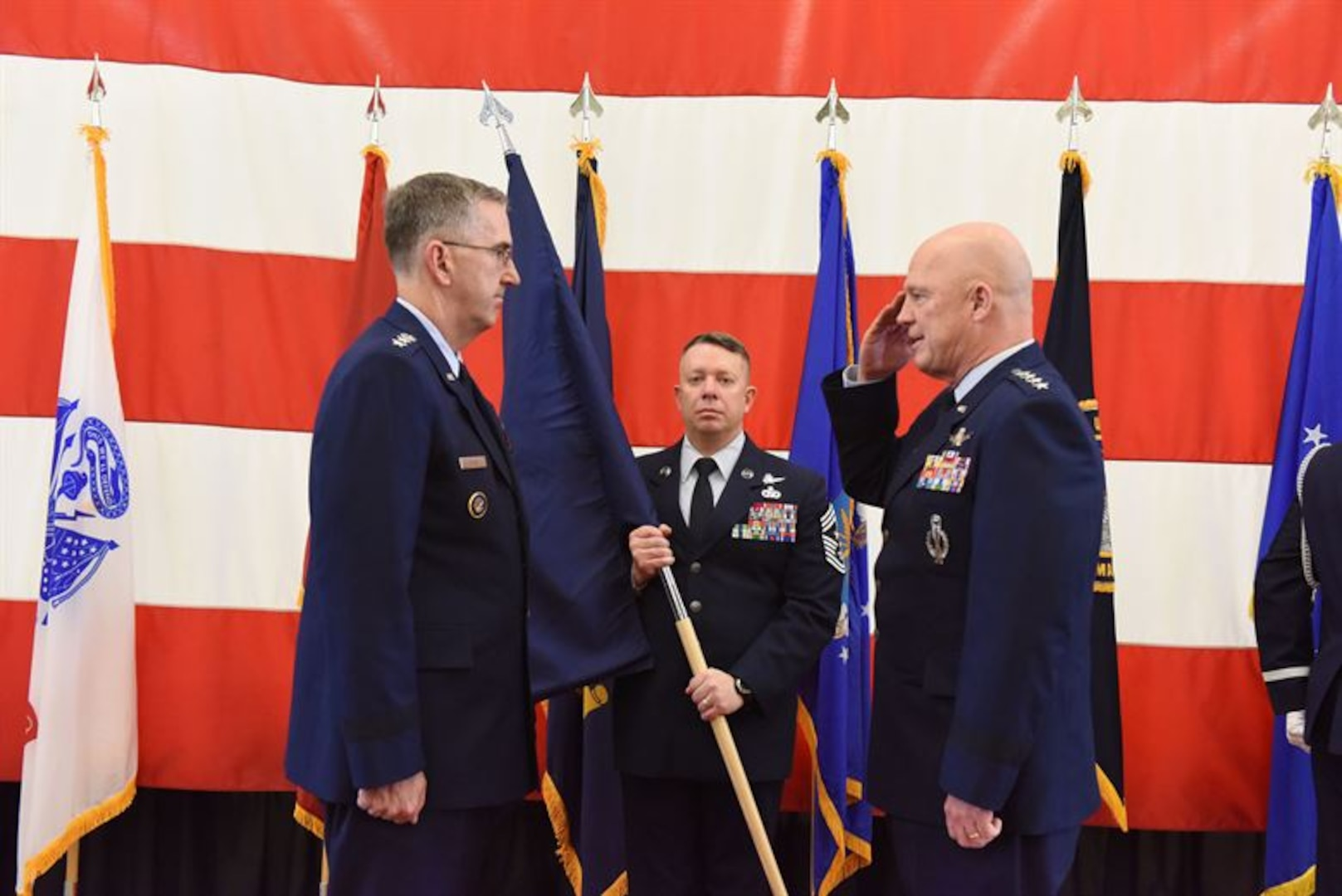 Air Force Gen. Jay Raymond, commander of Air Force Space Command, salutes Air Force Gen. John Hyten, commander of U.S. Strategic Command, during a ceremony at Vandenberg Air Force Base, Calif., Dec. 1, 2017. Raymond became the Joint Force Space Component commander taking operational responsibility for employment of all joint space forces.