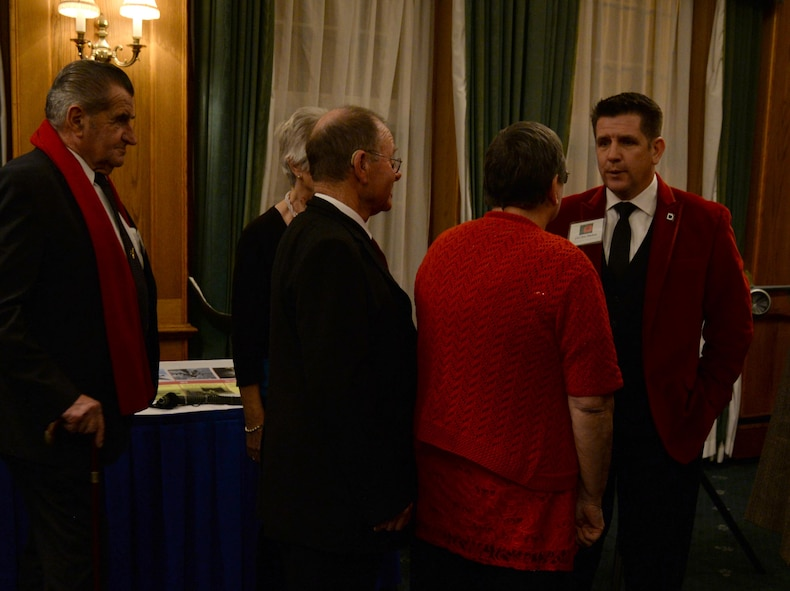 U.S. Air Force Col. Christopher Amrhein, 100th Air Refueling Wing commander, right, greets guests at the Yuletide reception Dec. 1, 2017, hosted on RAF Mildenhall, England. Previous to meeting the commander, guests viewed displays highlighting the missions of the 100th ARW, the 352d Special Operations Wing and the 48th Fighter Wing. (U.S. Air Force photo by Senior Airman Justine Rho)
