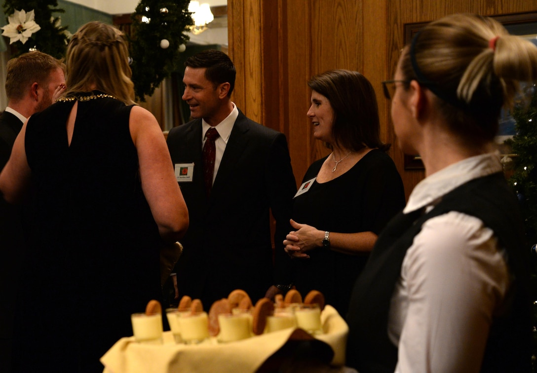 U.S. Air Force Col. Matthew Smith, 352d Special Operations Wing commander, greets guests at the Yuletide reception Dec. 1, 2017, hosted on RAF Mildenhall, England. Previous to meeting the commander, guests had the opportunity to speak with Airmen and learn about the missions of the 100th ARW, the 352d Special Operations Wing and the 48th Fighter Wing. (U.S. Air Force photo by Senior Airman Justine Rho)