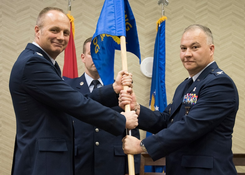 Col. Bret V. Fehrle assumes command of the 188th Medical Group from Col. Robert I. Kinney, Commander 188th Wing, during a change of command ceremony at Fort Smith, AR., Dec. 02, 2017. The passing of the guidon is a military custom signifying the transfer of command. (U.S. Air National Guard photo by Tech. Sgt. Daniel Condit)