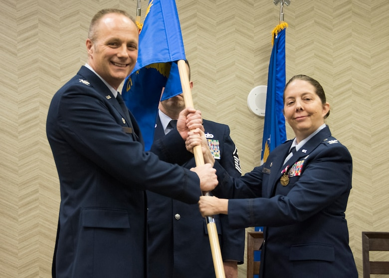 Col. Misty M. Zelk relinquishes command of the 188th Medical Group to Col. Robert I. Kinney, Commander 188th Wing, during a change of command ceremony at Fort Smith, AR., Dec. 02, 2017. The passing of the guidon is a military custom signifying the transfer of command. (U.S. Air National Guard photo by Tech. Sgt. Daniel Condit)