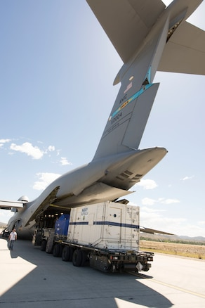 Cargo is unloaded from a military aircraft.