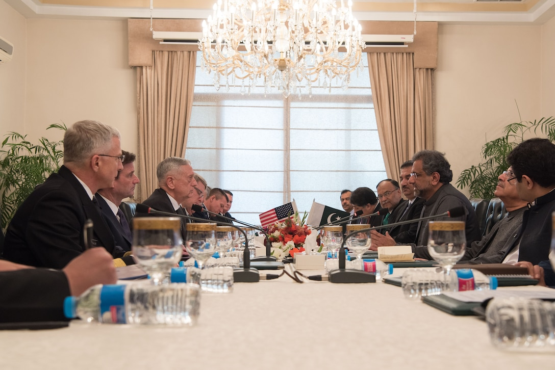 Defense Secretary James N. Mattis and the Pakistani prime minister sit across from each other at a table with other officials.