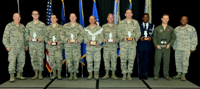 Brig. Gen. John D. Slocum (pictured far left), commanding officer of the 127th Wing and Selfridge Air National Guard base, and Chief Master Sgt. Tony Whitehead (pictured far right), command chief of the 127th Wing, awarded members with 2017 Airmen of the year honors here on Sunday.