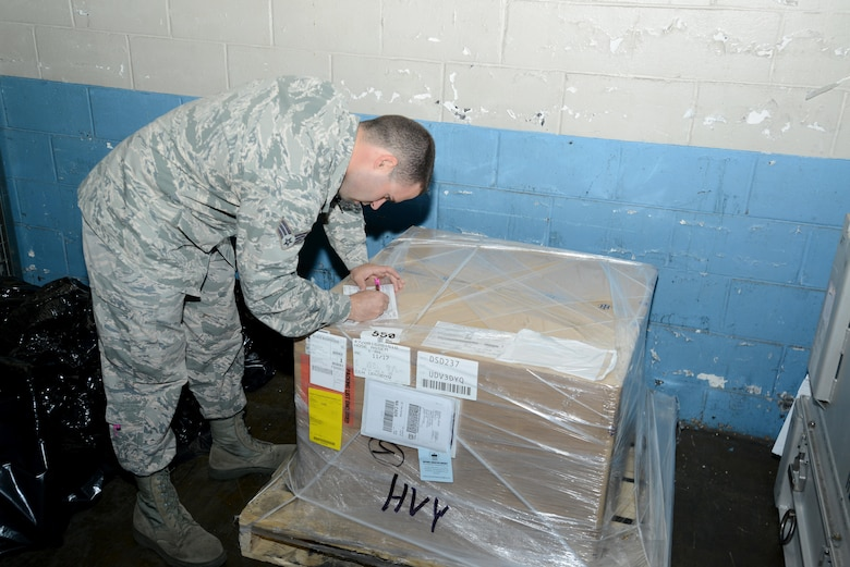U.S. Air Force Senior Airman Adam Roberts, 20th Logistics Readiness Squadron (LRS) transportation management office inbound supervisor, signs a label for a package at Shaw Air Force Base, South Carolina, Nov. 29, 2017.