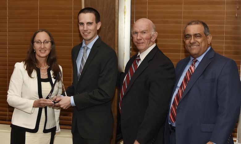 Christopher Bowman, NAS test operations engineer (second from left), receives the Security Award from NAS General Manager Cynthia Rivera during the National Aerospace Solutions 2017 Salute to Excellence Annual Awards Banquet held Nov. 16 at the Arnold Lakeside Center, Arnold Air Force Base, Tenn. NAS Deputy General Manager Doug Pearson and NAS Business Services Manager Mike Lugo pictured at right. (U.S. Air Force photo/Rick Goodfriend)