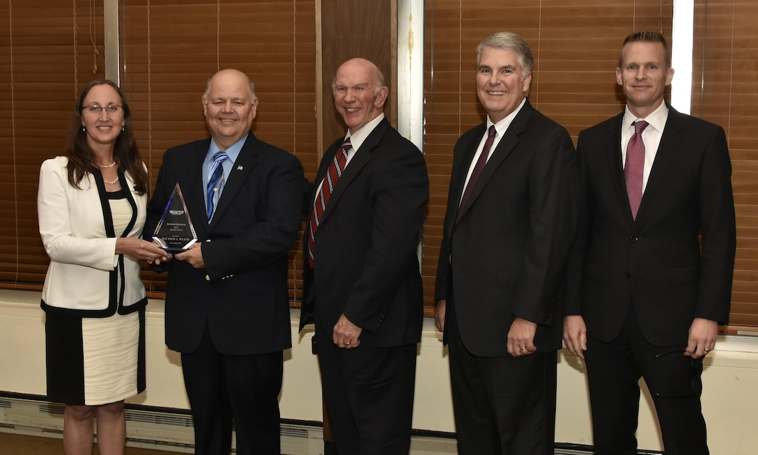 Matthew Wilson (second from left), NAS test operations quality specialist,  receives the Quality Award from NAS General Manager Cynthia Rivera during the National Aerospace Solutions 2017 Salute to Excellence Annual Awards Banquet held Nov. 16 at the Arnold Lakeside Center, Arnold AFB, Tenn.. Also pictured is NAS Deputy General Manager Doug Pearson, NAS Test and Sustainment Engineering Manager Jeff Henderson and NAS Integrated Resources Director Ben Souther. (U.S. Air Force photo/Rick Goodfriend)
