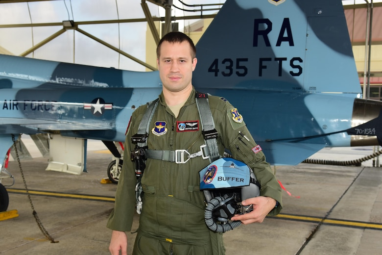 Capt. Joshua Smith, 435th Fighter Training Squadron flight commander and instructor pilot, stands by the tail of a T-38C Talon Sept. 20, 2017, at Joint Base San Antonio-Randolph, Texas. Smith Relied on his training to overcome the failure of one his T-38's engines and guided the aircraft to an airfield for a safe landing. (courtesy photo)