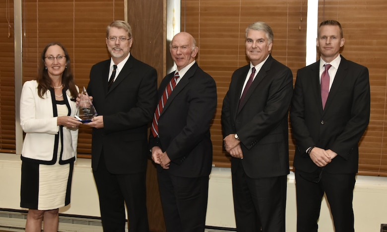Hunter Beavers (second from left), NAS mechanical systems engineer, receives the Safety Award from NAS General Manager Cynthia Rivera, during the National Aerospace Solutions 2017 Salute to Excellence Annual Awards Banquet at the Arnold Lakeside Center, Arnold AFB, Tenn., Nov. 16. Also pictured is NAS Deputy General Manager Doug Pearson, NAS Test and Sustainment Engineering Manager Jeff Henderson and NAS Integrated Resources Director Ben Souther. (U.S. Air Force photo/Rick Goodfriend)