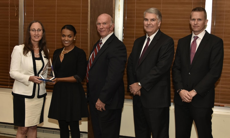Yeshiemebe Dohrmann (second from left), NAS mechanical design engineer, receives the Engineering Analysis of the Year Award from NAS General Manager Cynthia Rivera during the National Aerospace Solutions 2017 Salute to Excellence Annual Awards Banquet held Nov. 16 at the Arnold Lakeside Center, Arnold AFB. Also pictured is NAS Deputy General Manager Doug Pearson, NAS Test and Sustainment Engineering Manager Jeff Henderson, and NAS Integrated Resources Director Ben Souther. (U.S. Air Force photo/Rick Goodfriend)