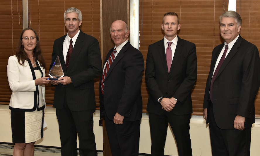 John Shuttleworth (second from left), Capital Project manager, receives the Project Manager of the Year Award from NAS General Manager Cynthia Rivera during the National Aerospace Solutions 2017 Salute to Excellence Annual Awards Banquet held Nov. 16 at the Arnold Lakeside Center, Arnold AFB. Also pictured is NAS Deputy General Manager Doug Pearson, NAS Integrated Resources Director Ben Souther and NAS Test and Sustainment Engineering Manager Jeff Henderson. (U.S. Air Force photo/Rick Goodfriend)
