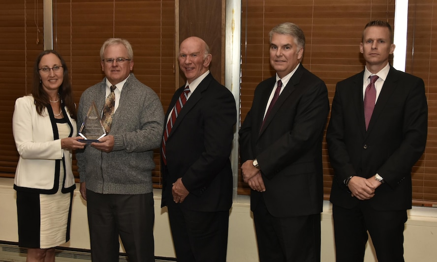 William Lynch (second from left), NAS lead machinist, receives the Craft Professional of the Year Award from NAS General Manager Cynthia Rivera during the National Aerospace Solutions 2017 Salute to Excellence Annual Awards Banquet held Nov. 16 at the Arnold Lakeside Center, Arnold AFB. Also pictured is NAS Deputy General Manager Doug Pearson, NAS Test and Sustainment Engineering Manager Jeff Henderson, and NAS Integrated Resources Director Ben Souther. (U.S. Air Force photo/Rick Goodfriend)