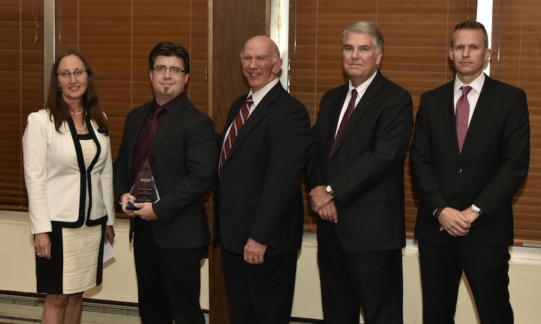 Joel Barr (second from left), NAS electrical engineer, receives the Engineer of the Year Award from NAS General Manager Cynthia Rivera during the National Aerospace Solutions 2017 Salute to Excellence Annual Awards Banquet held Nov. 16 at the Arnold Lakeside Center, Arnold AFB. Also pictured is NAS Deputy General Manager Doug Pearson, NAS Test and Sustainment Engineering Manager Jeff Henderson and NAS Integrated Resources Director Ben Souther. (U.S. Air Force photo/Rick Goodfriend)