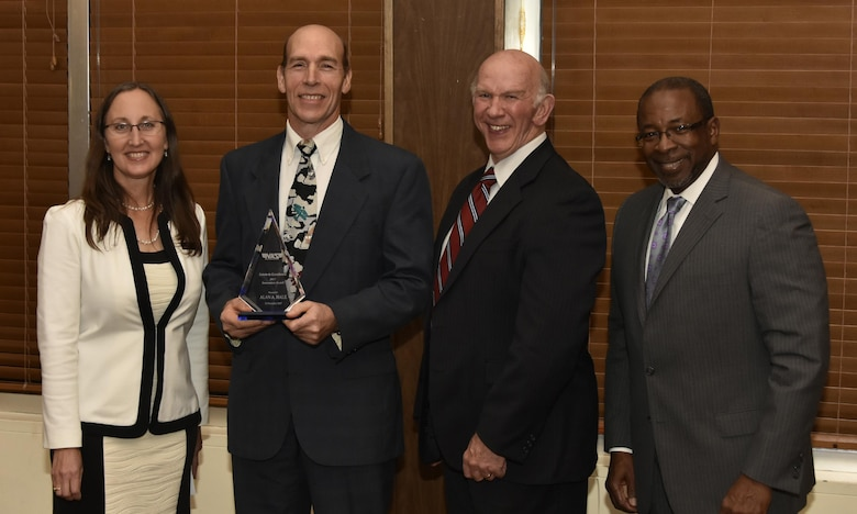 Dr. Alan Hale (second from left), NAS Model & Simulation engineer, receives the Innovation Award from NAS General Manager Cynthia Rivera during the National Aerospace Solutions 2017 Salute to Excellence Annual Awards Banquet Nov. 16 at the Arnold Lakeside Center, Arnold AFB. Also pictured is NAS Deputy General Manager Doug Pearson and NAS Technical Director Woodrow Whitlow. (U.S. Air Force photo/Rick Goodfriend)