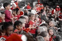 Children from the Child Development Center get ready to sing during the Tree Lighting Ceremony, Dec. 1, 2017, at Moody Air Force Base, Ga. The annual event brings the base community together as a way to show thanks for their continuous sacrifice and celebrate the holiday season. The celebration included a parade, raffle give-a-ways, children's activities and traditional lighting of the base Christmas tree by families of deployed Airmen. (U.S. Air Force photo illustration by Airman 1st Class Erick Requadt)