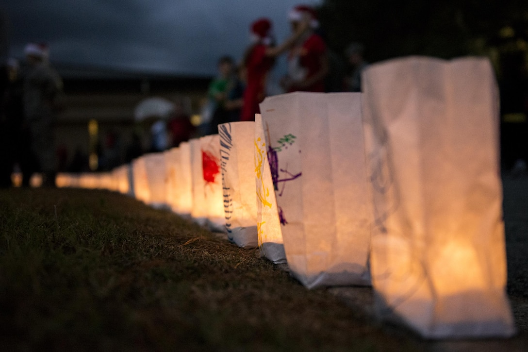 Illuminated paper bags rest on a curb during the Tree Lighting Ceremony, Dec. 1, 2017, at Moody Air Force Base, Ga. The annual event brings the base community together as a way to show thanks for their continuous sacrifice and celebrate the holiday season. The celebration included a parade, raffle give-a-ways, children's activities and traditional lighting of the base Christmas tree by families of deployed Airmen. (U.S. Air Force photo by Airman 1st Class Erick Requadt)