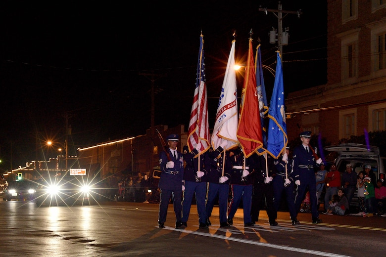 Goodfellow Color Guard marches during the 17th annual Lights of Christmas Parade in San Angelo, Texas, Dec. 2, 2017. Goodfellow Air Force Base led the 17th annual Lights of Christmas Parade through downtown San Angelo. The Goodfellow color guard was followed by U.S. Air Force Col. Ricky Mills, 17th Training Wing commander, and his wife Megan Mills. U.S Air Force Photo by Airman 1st Class Randall Moose/Released)