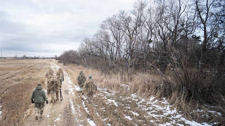 Defenders from the 791st Missile Security Forces Squadron search for hiding locations during joint-unit training at Minot Air Force Base, N.D., Nov. 22, 2017. During the joint-unit training, 791 MSFS defenders evaded capture by 5th Security Forces Squadron K9s and their handlers. (U.S. Air Force photo by Senior Airman J.T. Armstrong)