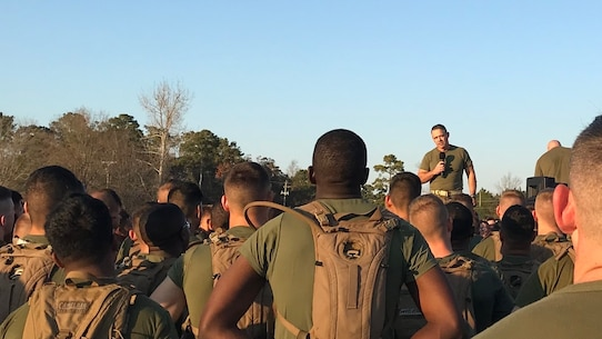 Colonel James H. Bain, Commanding Officer of Marine Corps Engineer School; addresses permanent personnel and students after physical training at Courthouse Bay, N. C. on December 1, 2017.