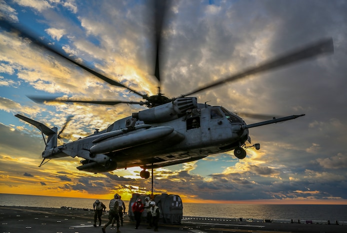 A U.S. Marine Corps CH-53E Super Stallion helicopter with Marine Medium Tiltrotor Squadron (VMM) 162 (Reinforced), 26th Marine Expeditionary Unit (MEU), picks up an AV-8B Harrier engine to transport it from the amphibious assault ship USS Iwo Jima (LHD 7) to the fleet replenishment ship USNS Big Horn (T-AO-198) during a Helicopter Support Team mission as part of Combined Composite Training Unit Exercise (COMPTUEX), Dec. 1, 2017, in the Atlantic Ocean. The exercise allows all elements of the Marine Air Ground Task Force (MAGTF) to join and train in realistic scenarios so the MEU as a whole can meet its Pre-Deployment Training Program objectives prior to their upcoming deployment at sea.