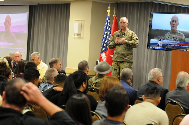 Major General Patrick J. Reinert, 88th Readiness Division commanding general, speaks to the more than 300 Soldiers and family members attending the Yellow Ribbon event in Minneapolis December 2.