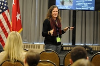 Sergeant 1st Class Jolaina Falkenstein, from the 88th Readiness Division, presents a class about homecoming and reintegration to more than 300 Soldiers and family members during the Yellow Ribbon event in Minneapolis December 2.