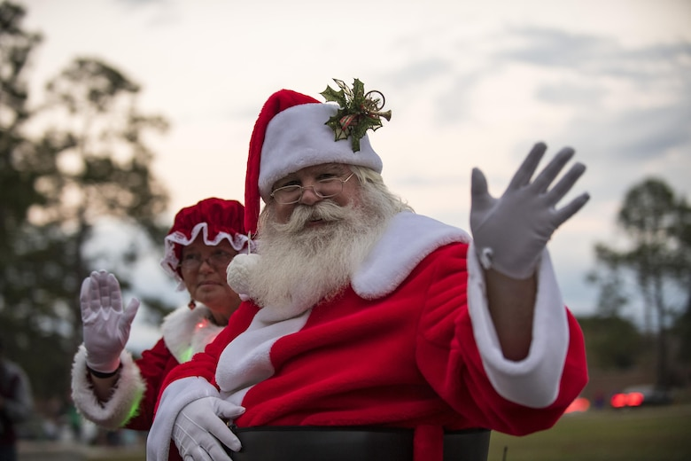 Santa and Mrs. Claus wave during a parade, Dec. 1, 2017, at Moody Air Force Base, Ga. The annual event brings the base community together as a way to show thanks for their continuous sacrifice and celebrate the holiday season. The celebration included a parade, raffle give-a-ways, children's activities and traditional lighting of the base Christmas tree by families of deployed Airmen. (U.S. Air Force photo by Andrea Jenkins)