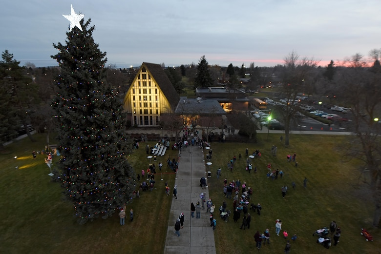 Team Fairchild gathers in front of the base chapel for the annual Holiday Tree Lighting Ceremony Dec. 1, 2017, at Fairchild Air Force Base, Washington. Santa Claus joined Team Fairchild and their families at the chapel for caroling, cookies, hot chocolate and the lighting of the holiday tree. (U.S. Air Force photo/Airman Whitney Laine)