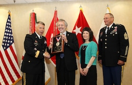 IWR and ICIWaRM Director Robert Pietrowsky accepts the 2013 LTG John W. Morris Civilian of the Year Award at the National Awards Dinner. Left to right: Maj. Gen. Todd T. Semonite, Robert A. Pietrowsky, Bob's wife Camille Torquato, and Command Sgt. Maj. Karl J. Groninger.