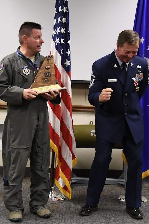 U.S. Air Force Senior Master Sgt. Darren Ellingwood, 307th Operations Support Squadron intelligence superintendent, reacts to a remark made by Lt. Col. Shawn Werchan, 307th OSS commander, during his retirement ceremony at Barksdale Air Force Base, La., Dec. 2, 2017.