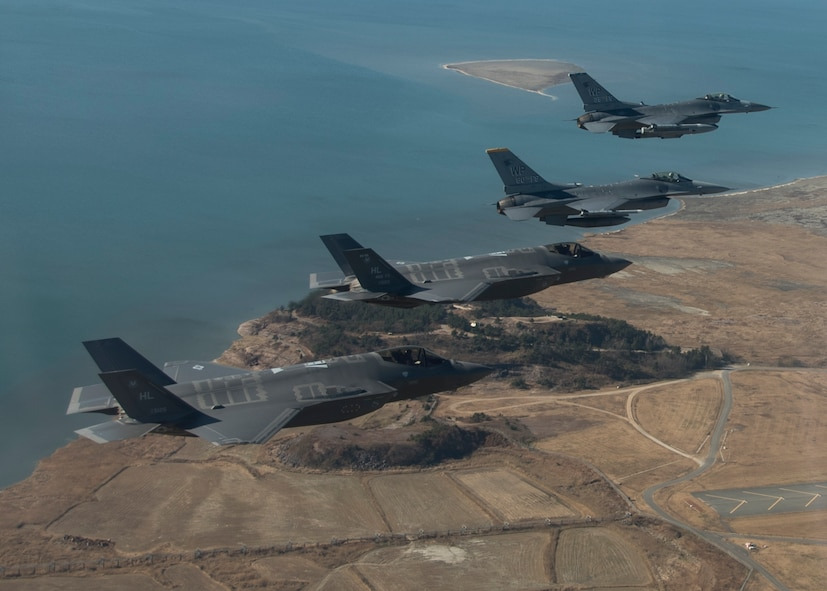 U.S. Air Force F-16 Fighting Falcons and F-35 Lightning IIs participate in a training mission near Kunsan Air Base, Republic of Korea, Dec. 1, 2017, in preparation for VIGILANT ACE 18. F-16 pilots assigned to the Wolf Pack at Kunsan conducted training missions with F-35 pilots from Hill Air Force Base, Utah, to test the capabilities of the fifth-generation aircraft during integrated flight operations over the Korean Peninsula. The participation of the F-35 in VIGILANT ACE 18 marked the aircraft's first operational readiness exercise in the Pacific (U.S. Air Force photo by TSgt Josh Rosales)
