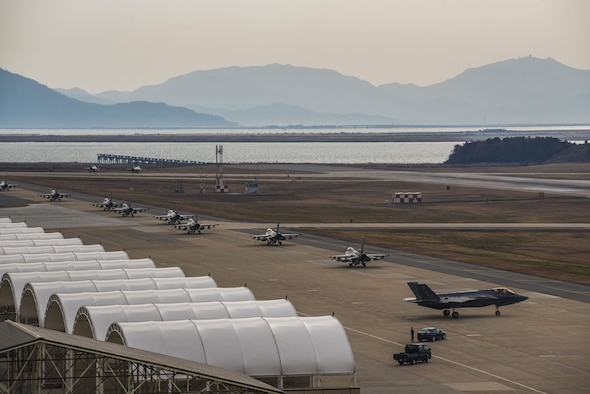 U.S. Air Force F-16 Fighting Falcons assigned to the 8th Fighter Wing taxi in front of an F-35A Lightning II assigned to Hill Air Force Base, Utah at Kunsan Air Base, Republic of Korea, Dec. 3, 2017. The 8th Fighter Wing hosted the fifth-generation strike fighters to train side-by-side during the week-long, bi-annual exercise VIGILANT ACE 18. (U.S. Air Force photo by Master Sgt. Frank W. Miller III)