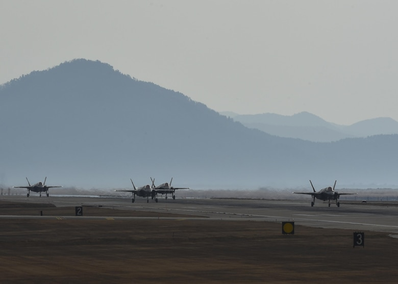 Four U.S. Air Force F-35A Lightning II's from the 34th Fighter Squadron, Hill Air Force Base, Utah, taxi down the runway at Kunsan Air Base, Republic of Korea, Dec. 3, 2017, during exercise VIGILANT ACE 18. The annual exercise featured 12,000 U.S. personnel working alongside members of the Republic of Korea Air Force at eight U.S. and ROK military installations. (U.S. Air Force photo by Tech Sgt. Joshua Rosales)