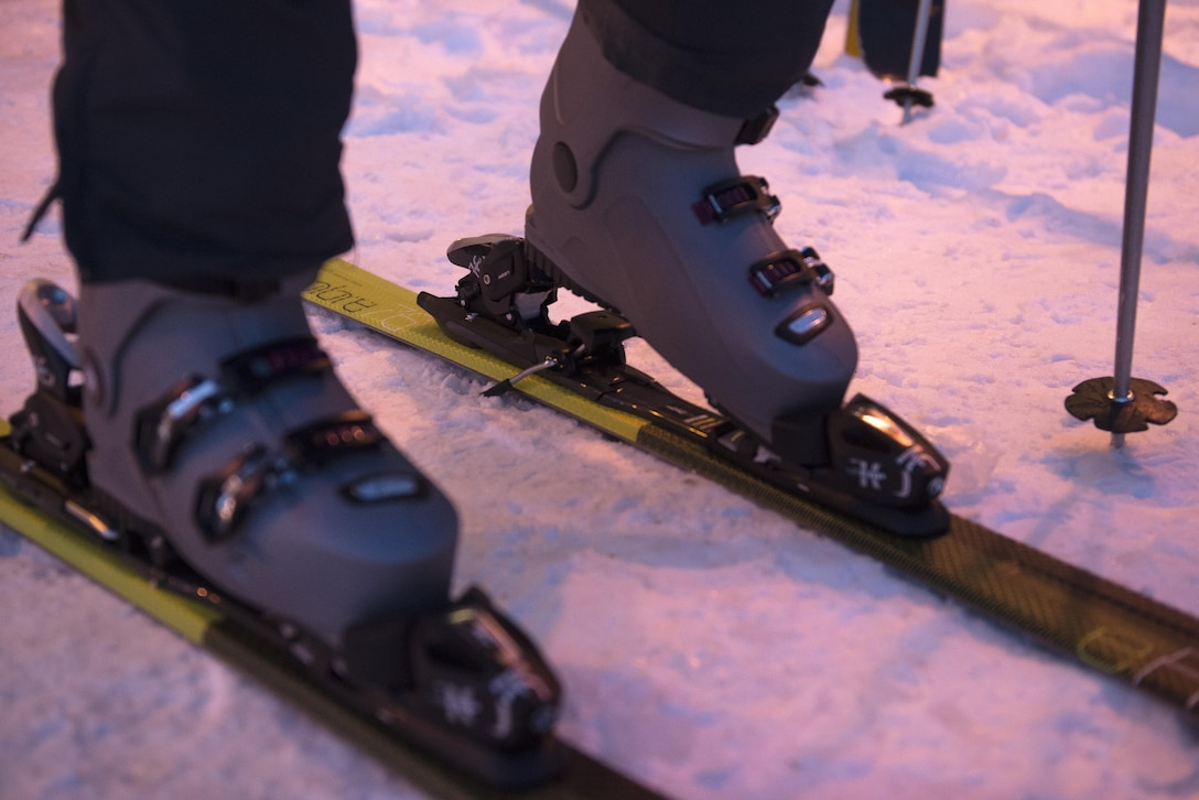 A skier puts on skis before heading up the hill at the Hillberg Ski Area at Joint Base Elmendorf-Richardson, Alaska, Dec. 1, 2017. Hillberg created their own snow and provided skiers and snowboarders a dual chairlift, sledding tow and handle tow.