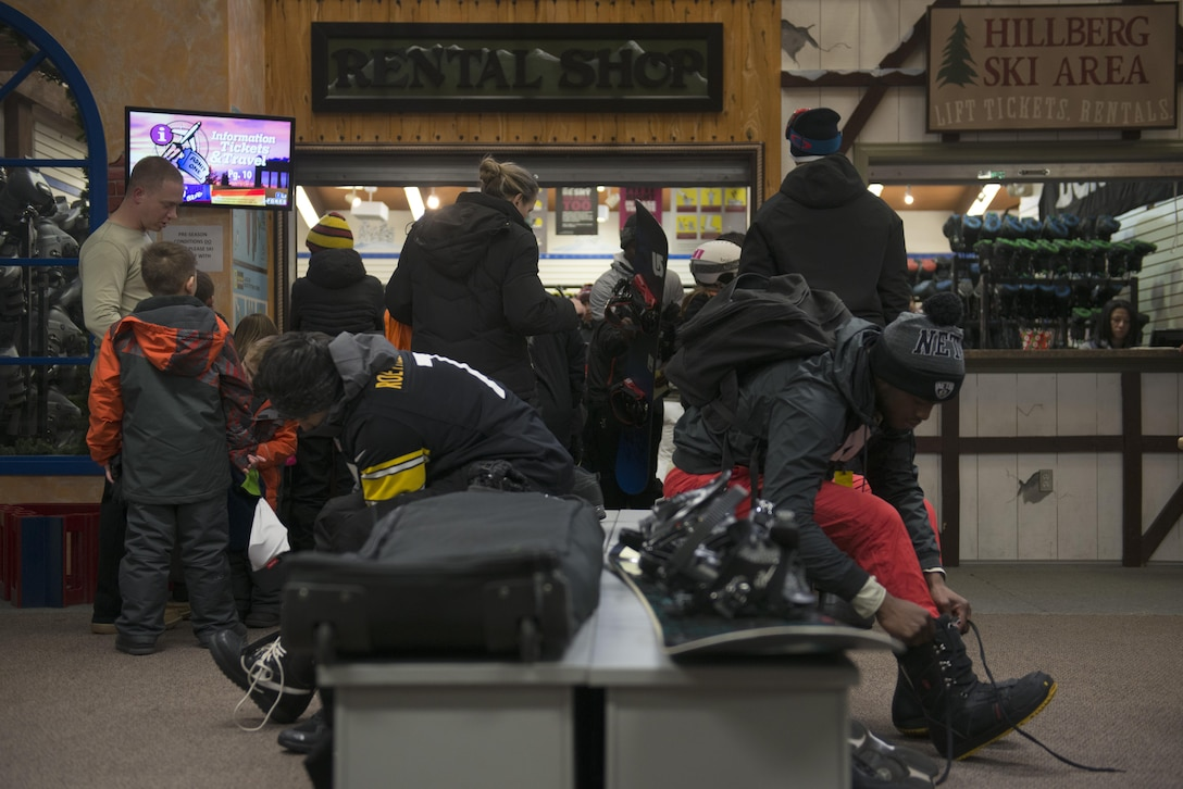 Skiers and snowboarders don their equipment at the Hillberg Ski Area during its opening day Dec. 1, 2017 at Joint Base Elmendorf-Richardson, Alaska. Hillberg created their own snow and provided skiers and snowboarders a dual chairlift, sledding tow and handle tow.