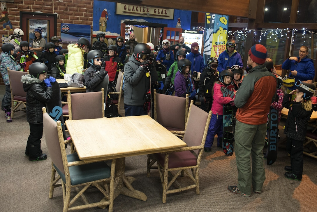 Karl Lavtar, Outdoor Adventure Program lead, instructs children at the Hillberg Ski Area before their first day of youth snow sports lessons at Joint Base Elmendorf-Richardson, Alaska, Dec. 1, 2017. The Kennecott Youth Center and Hillberg partnered up to provide children transportation to and from each facility, equipment rentals, and two-hour instruction on how to ski or snowboard.