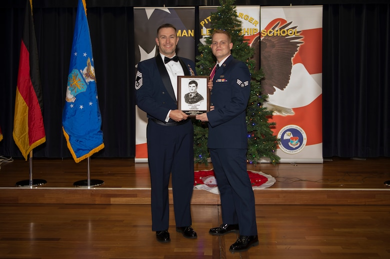 U.S. Air Force Senior Airman Matthew Smith, 52nd Communications Squadron mission defense team technician, receives the John L. Levitow during the Pitsenbarger Airman Leadership School 18-A graduation at Club Eifel on Spangdahlem Air Base, Germany, November 30,2017. The Levitow award is the highest honor given to the student who displays excellence in all categories of ALS. (U.S. Air Force photo by Senior Airman Dawn M. Weber)